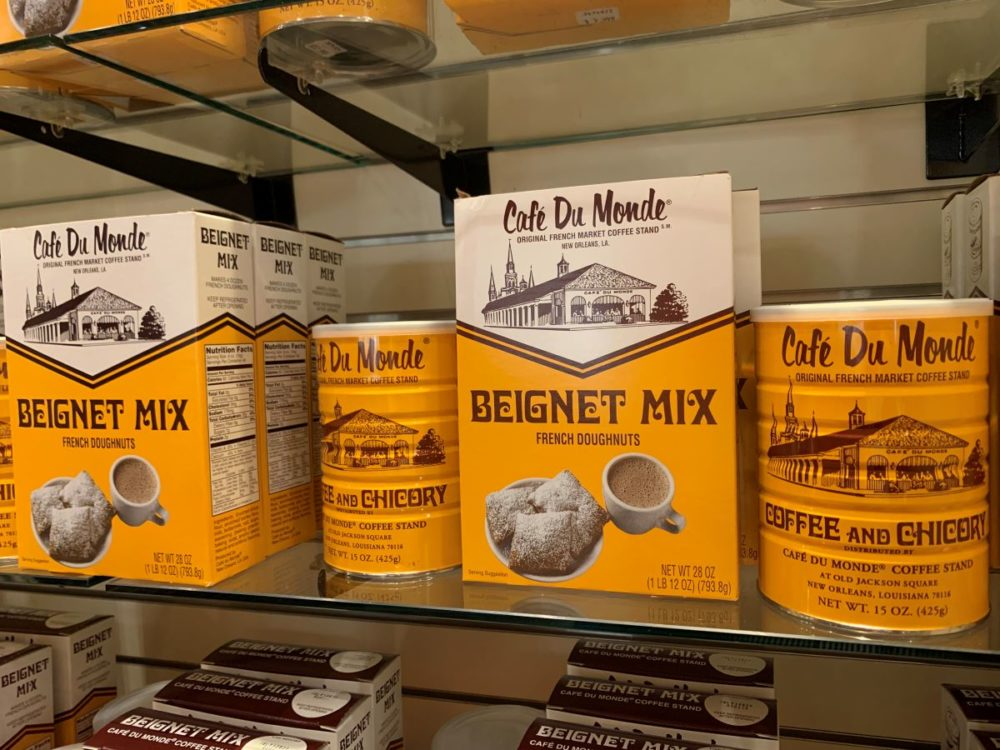 best souvenirs from New Orleans featured by top US travel blog, The Common Traveler: image of boxes of Cafe du Monde beignet mix and tins of coffee -