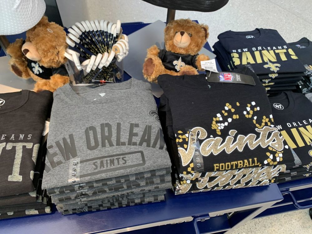 best souvenirs from New Orleans featured by top US travel blog, The Common Traveler: image of merchandise table with football saints memorabilia