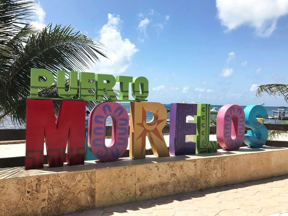 16 BEST PLACES TO VISIT IN MEXICO featured by top travel blog, The Common Traveler: image of Puerto Morelos sign in Mexico