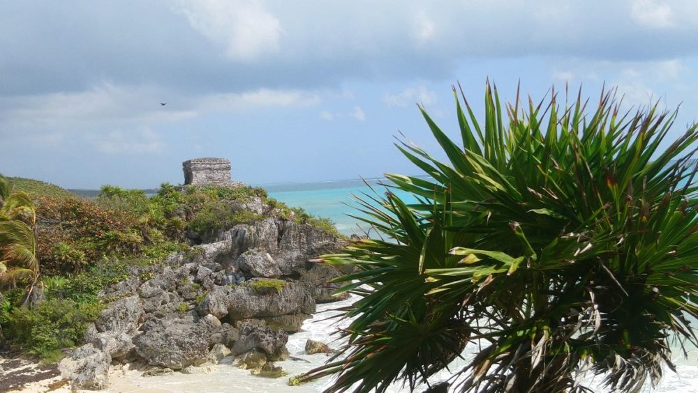 16 BEST PLACES TO VISIT IN MEXICO featured by top travel blog, The Common Traveler: image of Tulum ruins in background with beach