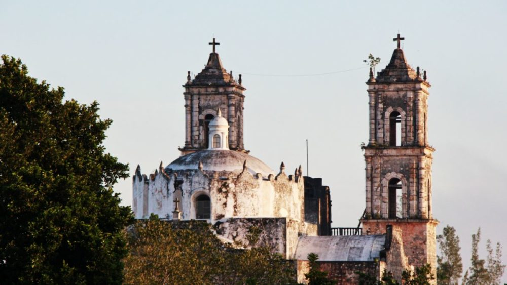16 BEST PLACES TO VISIT IN MEXICO featured by top travel blog, The Common Traveler: image of church in Valladolid, Mexico