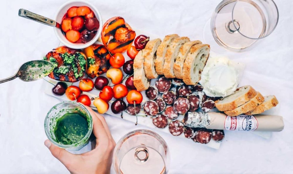 TOP 5 BEST FOOD CITIES IN THE WORLD FOR FOODIES IN  2020 featured by top travel blog, The Common Traveler: image of charcuterie board with tomatoes and cherries