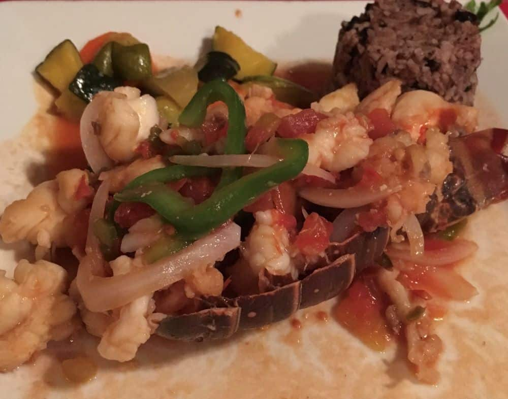 The Best Restaurants in San Pedro Belize featured by top travel blog, The Common Traveler; Photo of stuffed lobster tail at El Fogon