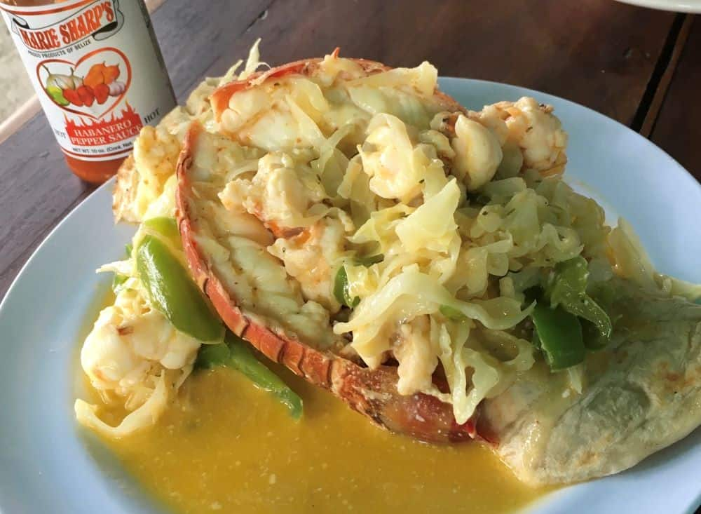 The Best Restaurants in San Pedro Belize featured by top travel blog, The Common Traveler; photo of lobster tail burrito at Waruguma