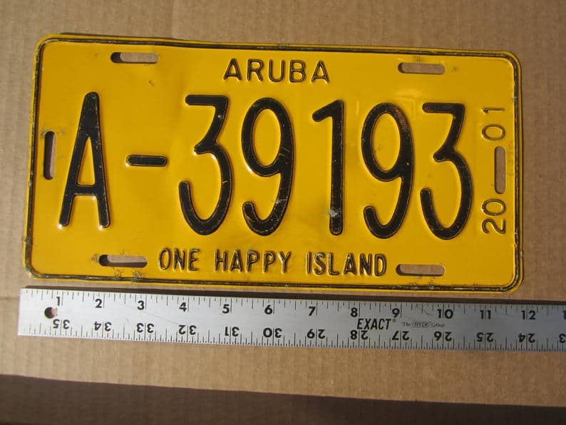 TOP 10 BEST ARUBA SOUVENIRS TO BUY featured by top travel blog, The Common Traveler: image of Aruba One Happy Island license plate