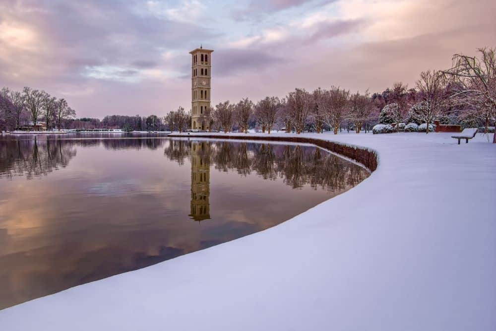 Bell Tower at Lake at Furman University in Greenville, SC in winter - with snow covered ground