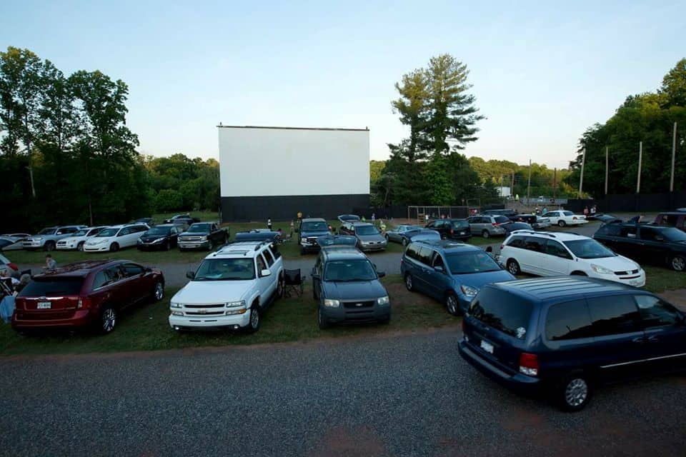 TOP 5 DRIVE-IN MOVIE THEATERS IN NC featured by top NC blog, The Common Traveler: image of Eden Drive-in Theater - cars in front of screen
