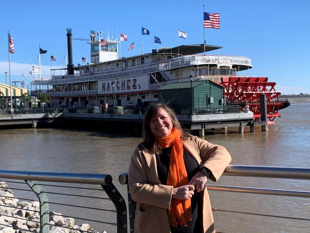 woman in front of paddleboat Natchez in New Orleans