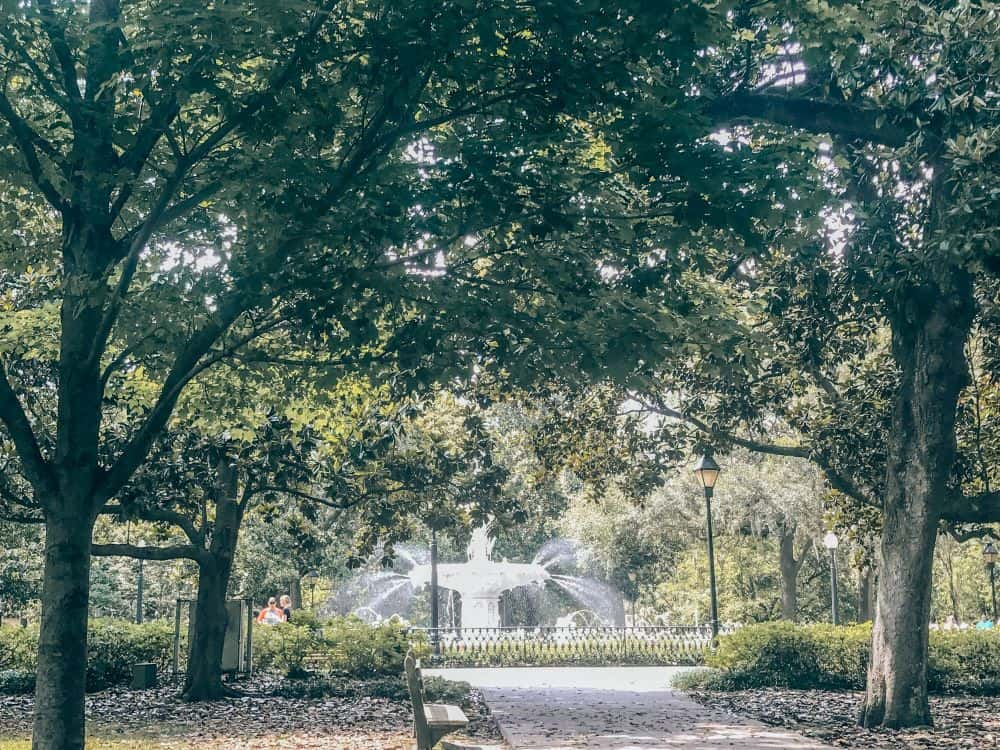 TOP 20 BEST WEEKEND GETAWAYS IN THE US featured by top US travel blog, The Common Traveler: image of  park with water fountain in Savannah, Georgia