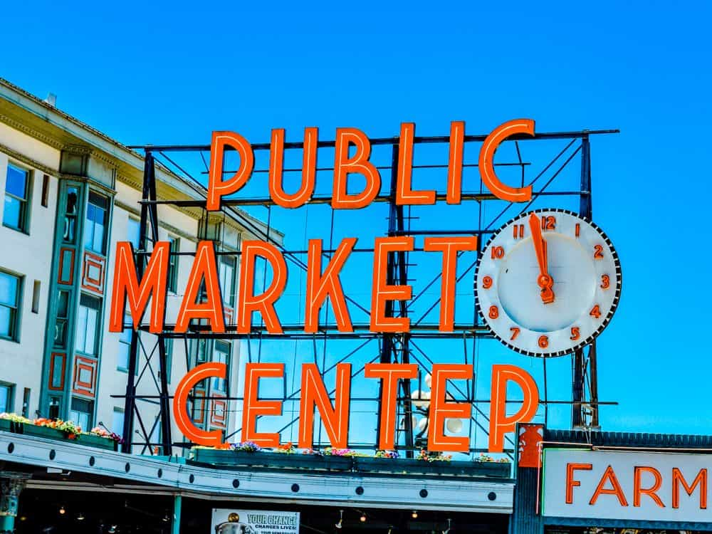 TOP 20 BEST WEEKEND GETAWAYS IN THE US featured by top US travel blog, The Common Traveler: image of  Public Market Center Sign in Seattle, Washington