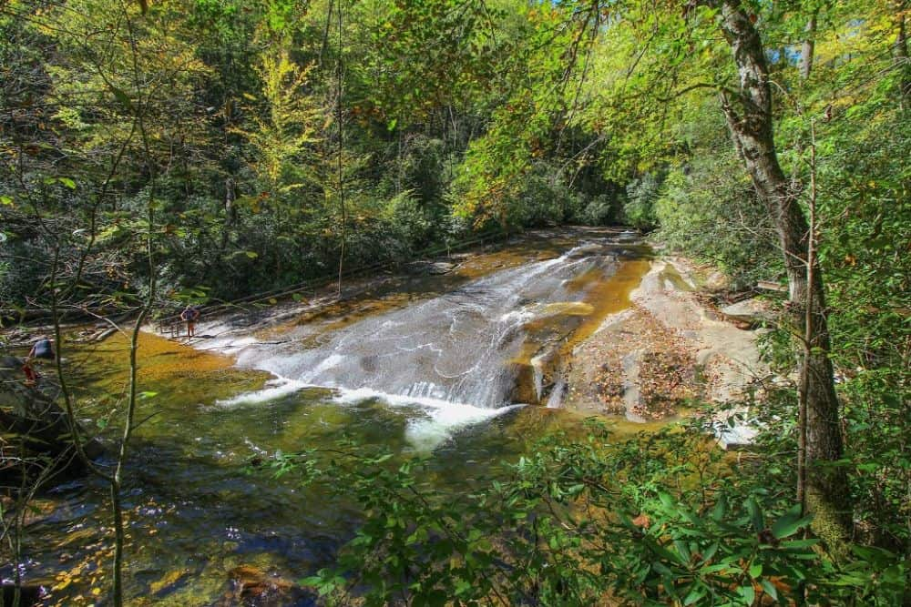 TOP 20 BEST WEEKEND GETAWAYS IN THE US featured by top US travel blog, The Common Traveler: image of  Sliding Rock, outside of Asheville, NC