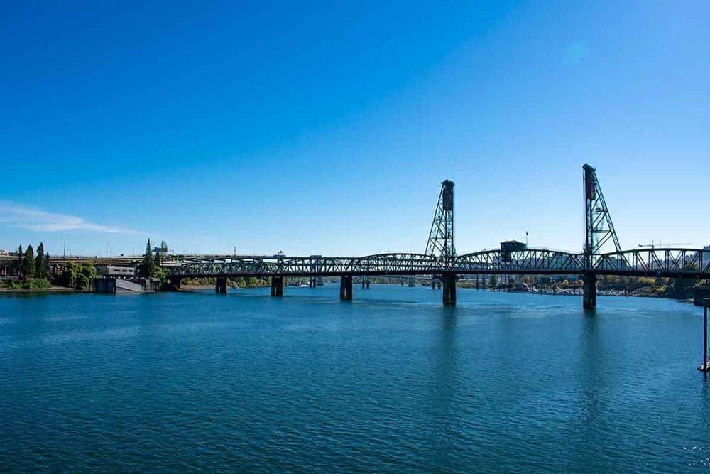 TOP 20 BEST WEEKEND GETAWAYS IN THE US featured by top US travel blog, The Common Traveler: image of  metal bridge over river in Portland, Oregon