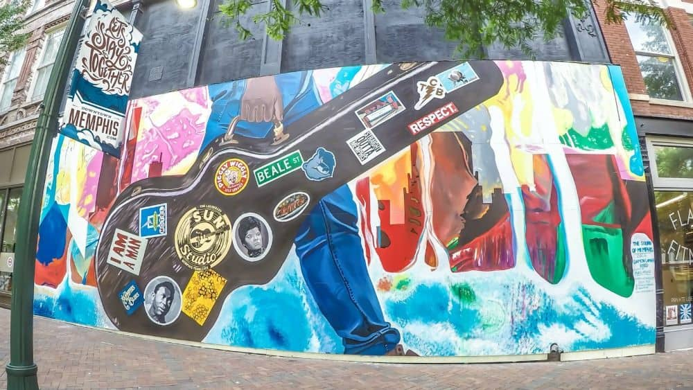 TOP 20 BEST WEEKEND GETAWAYS IN THE US featured by top US travel blog, The Common Traveler: image of  mural of guitar case in Memphis, Tennessee