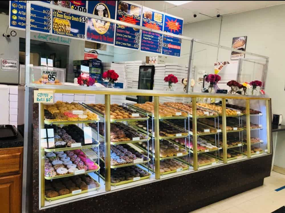 TOP 10 BEST DONUTS IN NORTH CAROLINA featured by top NC blogger, The Common Traveler: Display case with donuts at Baker's Dozen in Raleigh, NC - Best Donut Shops in NC