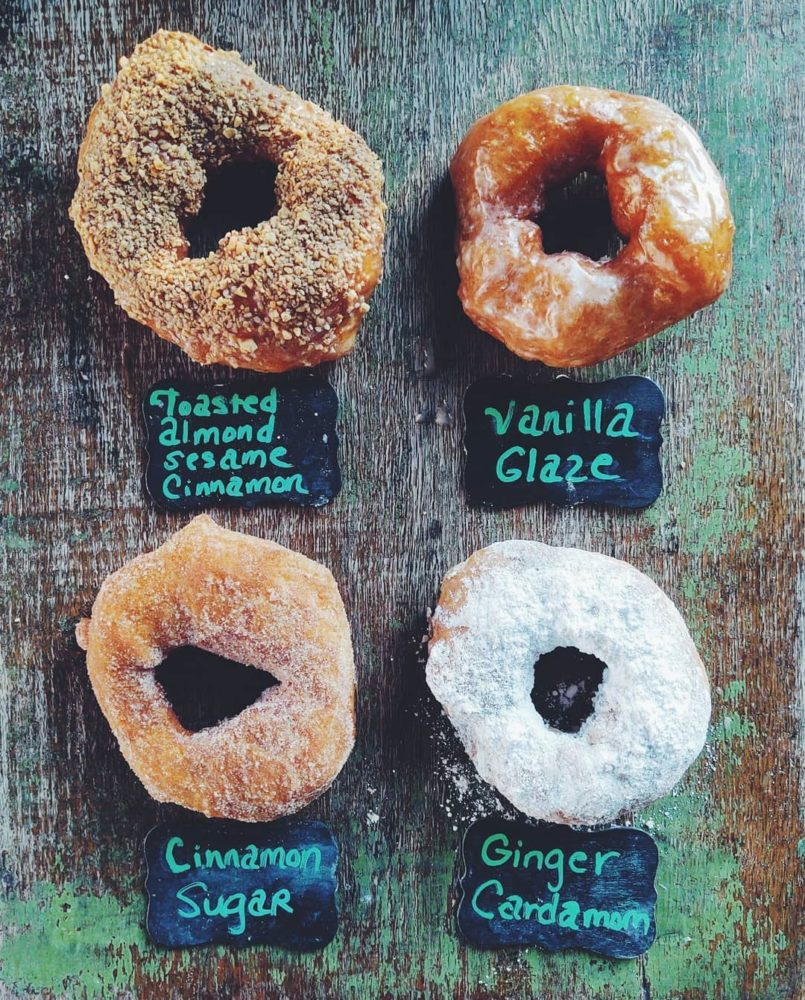 TOP 10 BEST DONUTS IN NORTH CAROLINA featured by top NC blogger, The Common Traveler: board with 4 donuts from Hole Doughnuts in Asheville, Best Donut Shops in NC