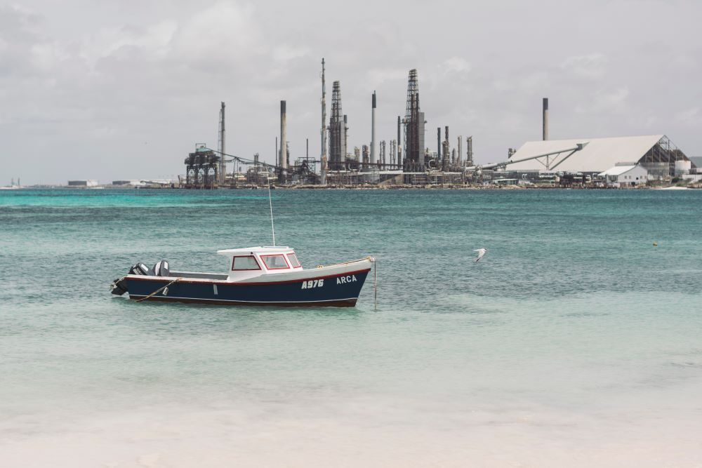 boat in front of oil refinery at Aruba beach