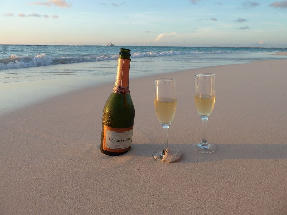 champagne bottle with flutes on Aruba beach