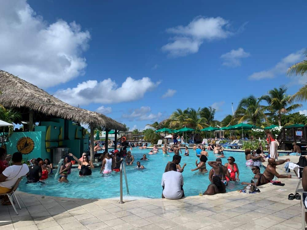 The best things to do in Grand Turk Island on port day featured by top cruise travel blogger, The Common Traveler: people in pool at Margaritaville in Grand Turk