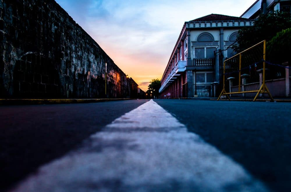 8 BEST THINGS TO DO IN MANILA Philippines featured by top travel blogger, The Common Traveler. Intramuros street from street level at sunrise