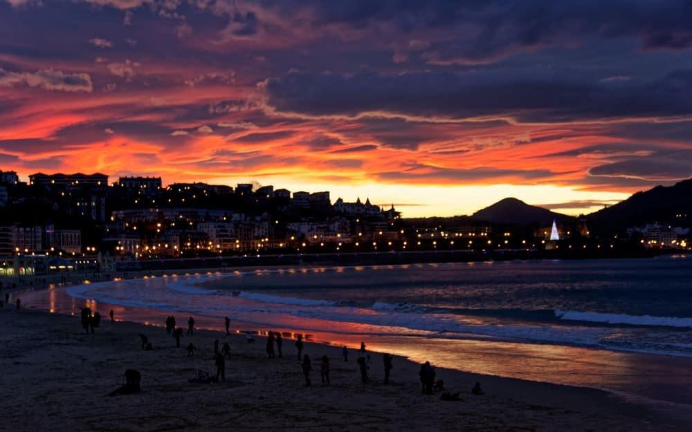 sunset over beach of San Sebastian in Spain