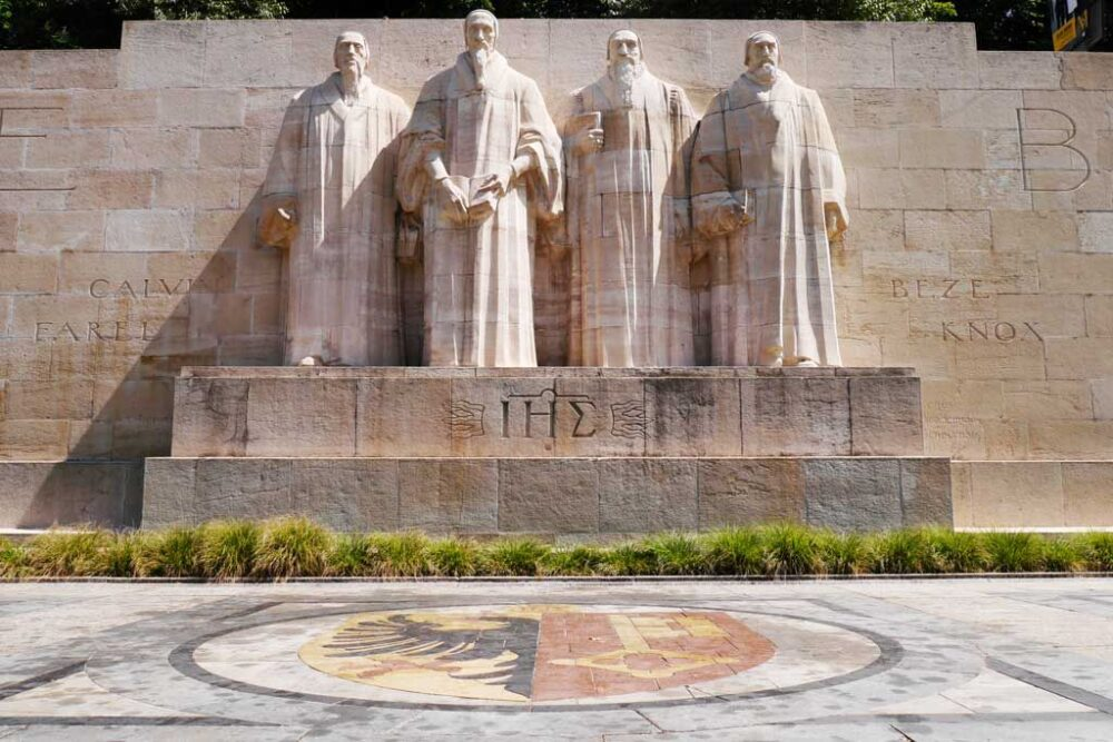TOP 6 BEST SIGHTS IN SWITZERLAND TO SEE IN 48 HOURS featured by top travel blogger, The Common Traveler: image of reformation wall in Geneva