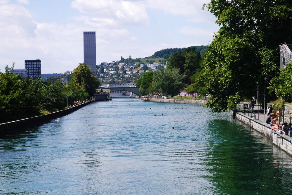 TOP 6 BEST SIGHTS IN SWITZERLAND TO SEE IN 48 HOURS featured by top travel blogger, The Common Traveler: image of swimming in Letten area in Zurich