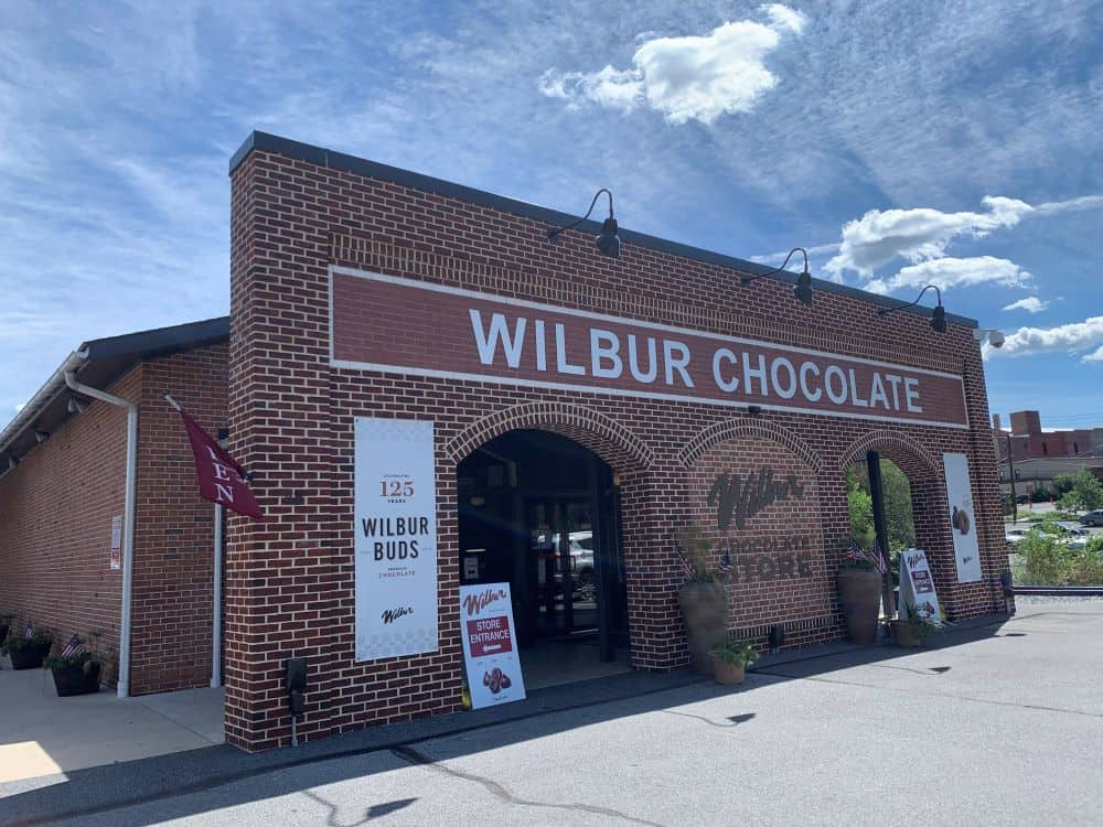 THE BEST THINGS TO DO IN LITITZ PA featured by top US travel blogger, The Common Traveler: image of brick building Wilbur Chocolate Store in Lititz, PA