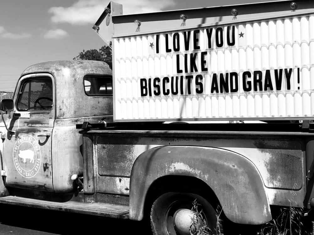 TOP 10 BEST BISCUITS IN NORTH CAROLINE YOU SHOULD TRY featured by top NC blogger, The Common Traveler. Image: old truck with sign: I love you like biscuits and gravy!