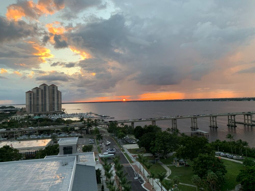 Top 6 best places to watch the sunset in SW Florida, featured by top US travel blog, The Common Traveler: image of view from Luminary Hotel Rooftop Bar, Fort Myers, FL