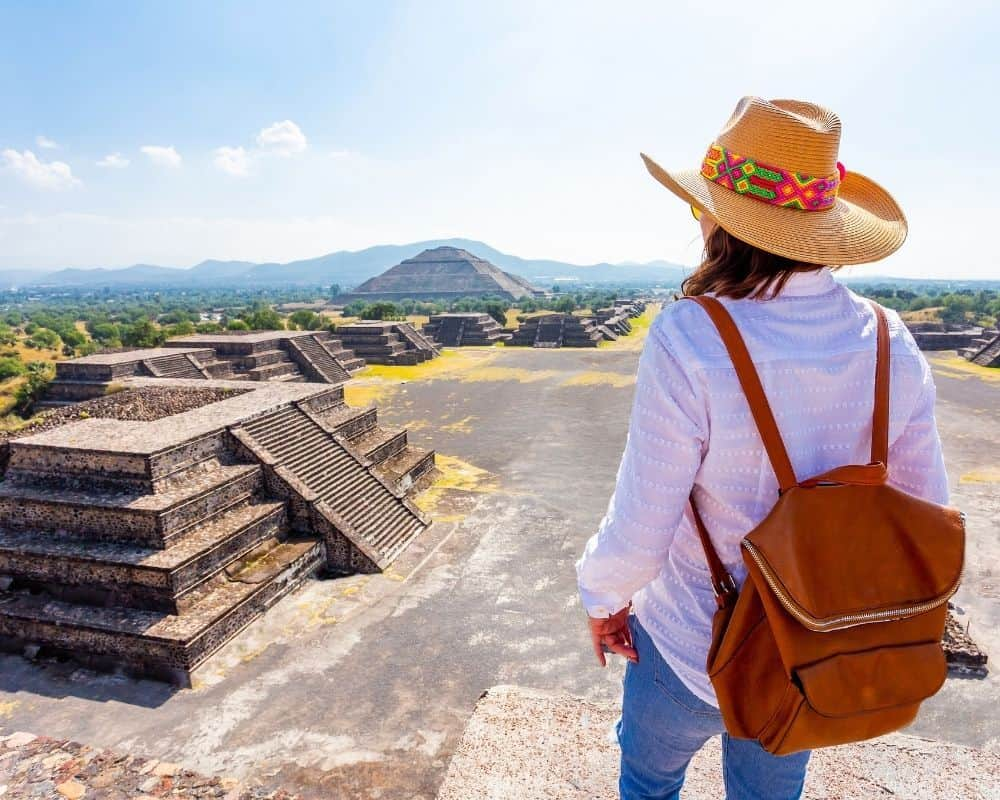 Mexico's Pueblos Magicos Worth Visiting by The Common Traveler: Image of woman on top of pyramid at Teotihuacan. |Pueblos Magicos Mexico by popular US international blog, The Common Traveler: image of a woman standing on top of a pyramid in Teotihuacan.