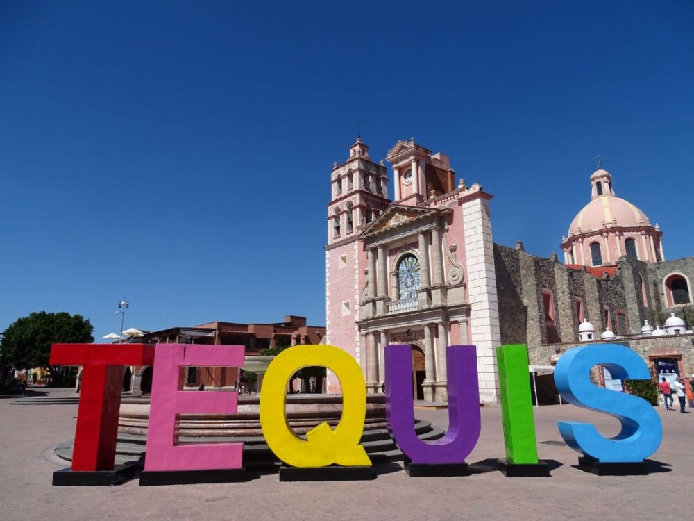 Mexico's Pueblos Magicos Worth Visiting by The Common Traveler: Image of letters spelling Tequis in front of church in Tequisquiapan. |Pueblos Magicos Mexico by popular US international blog, The Common Traveler: image of Tequisquiapan, Queretaro.