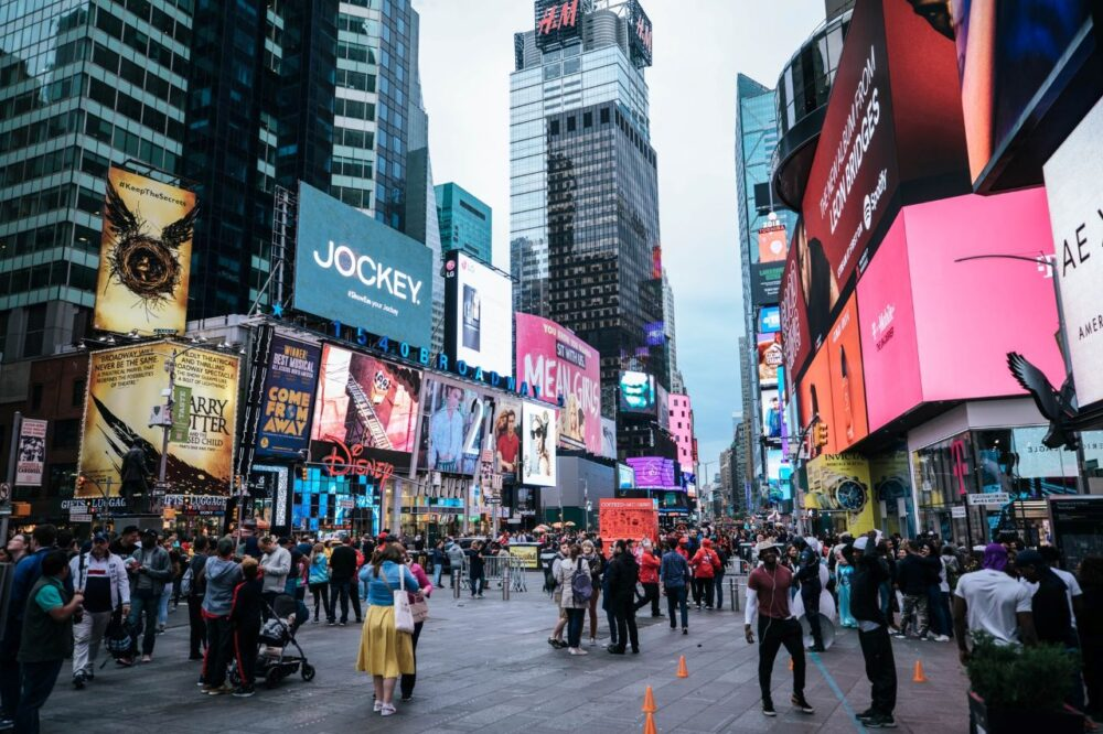 5 TOP PLACES TO VISIT IN NEW YORK CITY AT LEAST ONCE  featured by top US travel blogger, The Common Traveler: image of Times Square