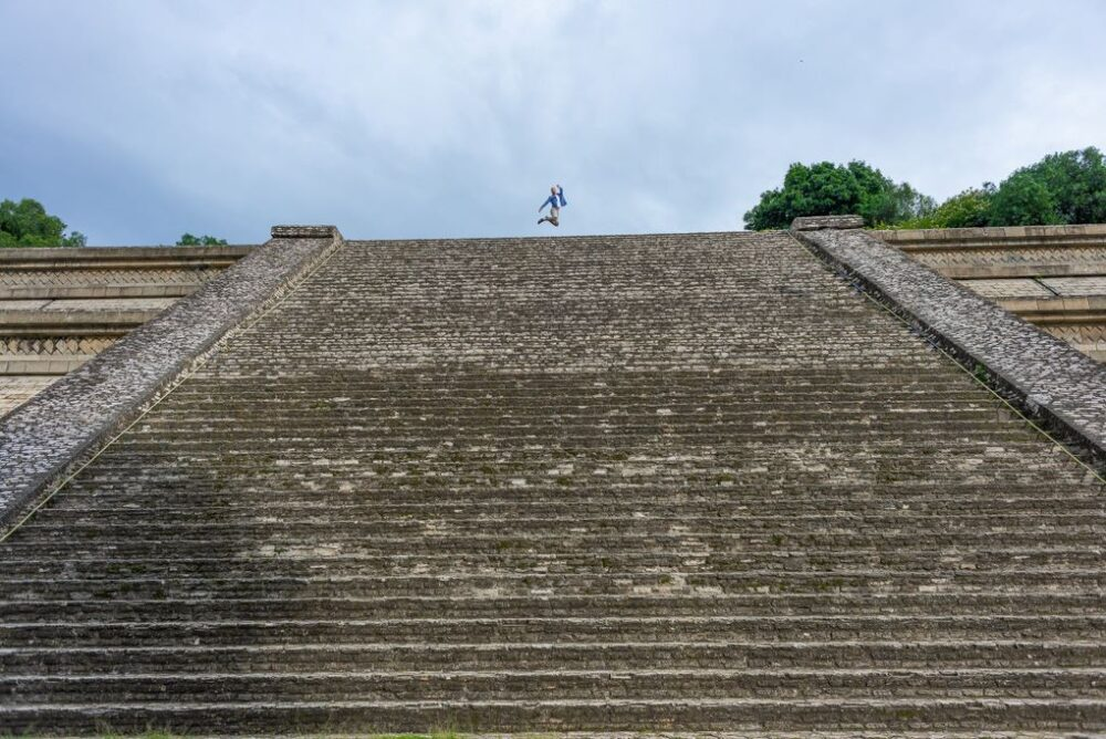 Mexico's Pueblos Magicos Worth Visiting by The Common Traveler: Image of woman jumping on top of the Great Pyramid of Cholula. |Pueblos Magicos Mexico by popular US international blog, The Common Traveler: image of Cholula, Puebla.