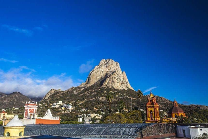 Mexico's Pueblos Magicos Worth Visiting by The Common Traveler: Image of Rock in Bernal with city in foreground. |Pueblos Magicos Mexico by popular US international blog, The Common Traveler: image of Bernal, Queretaro.