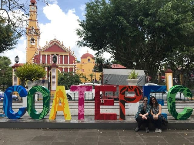 Mexico's Pueblos Magicos Worth Visiting by The Common Traveler: Image of two women in front of Coatepec sign. |Pueblos Magicos Mexico by popular US international blog, The Common Traveler: image of Coatepec, Veracruz.
