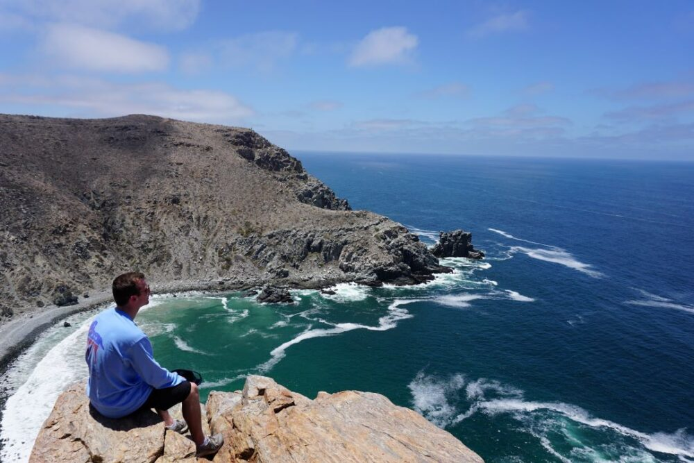 Mexico's Pueblos Magicos Worth Visiting by The Common Traveler: Image of man sitting overlooking shoreline of Todos Santos. |Pueblos Magicos Mexico by popular US international blog, The Common Traveler: image of Todos Santos, Baja California Sur.