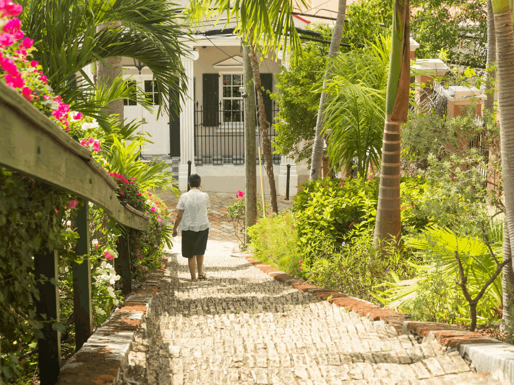 Image: woman walking down brick 99 brick steps in St. Thomas USVI | Best Things to do in the US Virgin Islands: image of a woman walking down the 99 steps in St. Thomas.