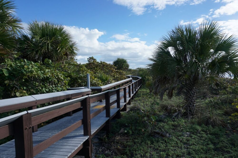 BEST THINGS TO DO IN BONITA SPRINGS, FL featured by top US travel blogger, The Common Traveler: image of boardwalk at Barefoot Beach, Bonita Beach, FL |Bonita Springs FL by popular US travel blog, The Common Traveler: image of the barefoot beach trail.