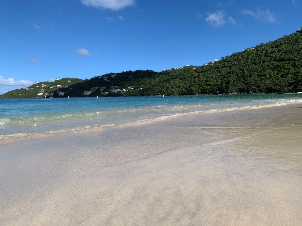 Image: white sand beach with mountain in background, Magens Bay, St. Thomas, USVI |Best Things to do in the US Virgin Islands: image of Magens Bay.
