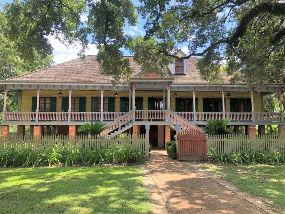 Best Day Trips from New Orleans | The Common Traveler | image: yellow plantation home with green shutters, Laura Plantation |New Orleans Day Trips by popular US travel blog, The Common Traveler: image of the Laura Plantation.