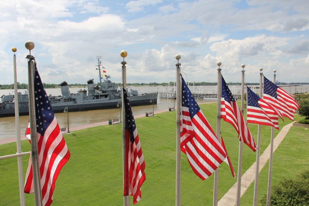 Best Day Trips from New Orleans | The Common Traveler | image: flag poles in front of USS Kidd in Baton Rouge |New Orleans Day Trips by popular US travel blog, The Common Traveler: image of the USS Kidd.