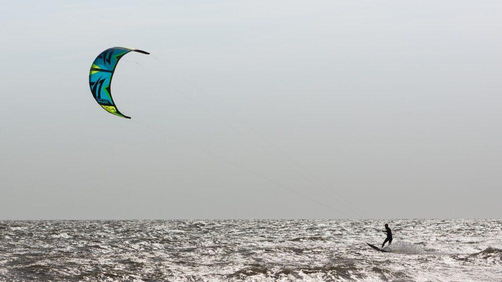 12 Amazing Canada Outdoor Activities | The Common Traveler | image: person kiteboarding |Canada Outdoor Activities by popular US international travel blog, The Common Traveler: image of someone kiteboarding in the ocean.