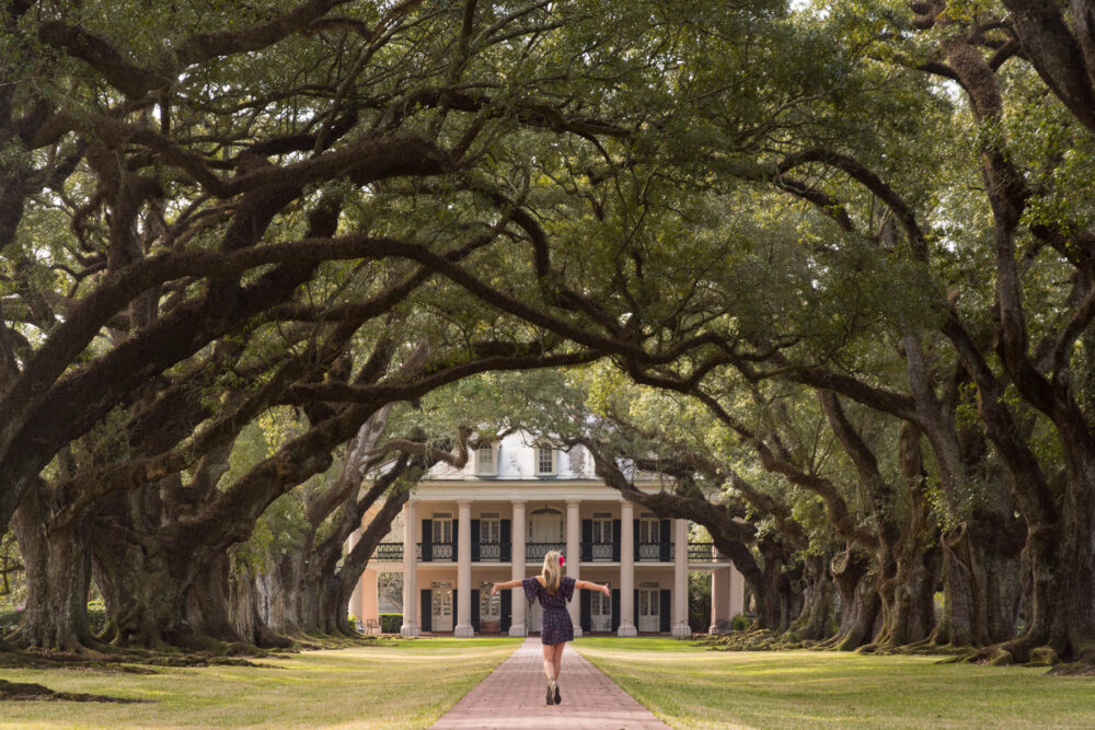 Best Day Trips from New Orleans | The Common Traveler | image: woman walking to Oak Alley Plantation near New Orleans |New Orleans Day Trips by popular US travel blog, The Common Traveler: image of Oak Alley Plantation.