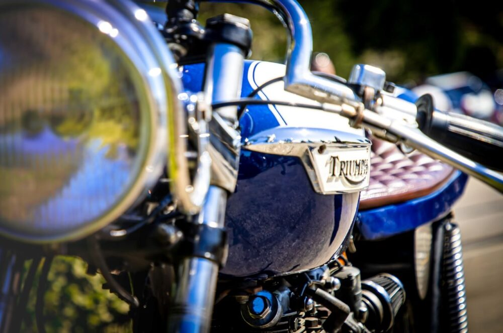 Six Amazing Motorcycle Rides Around the World | The Common Traveler | image: triumph motorcycle headlight and handle bar |Motorcycle Rides by popular US international travel blog, The Common Traveler: image of a Triumph motorcycle.